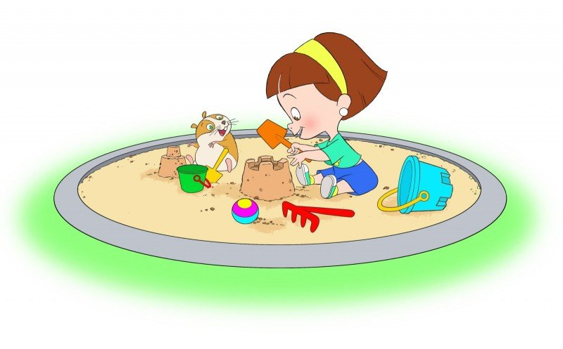Julieta jugando con bigotes en la arena del parque